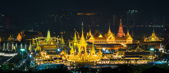 The Royal Cremation Ceremony of His Majesty of  King Bhumibol Adulyadej, stands tall in Sanam Luang  with Emerald Buddha and Wat Phra Kaew temple background