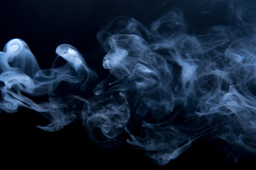The clubs smoke on a black background, horizontal. Fluid effect.