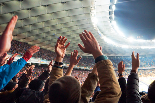 Football- Soccer,a lot of fans in full stadium celebrate there goal in open air roof stadium.