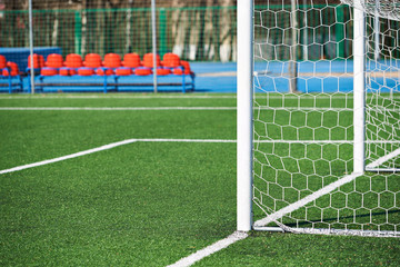 Goal post on football field with artificial lawn