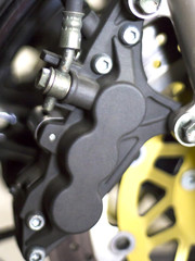 Device motorcycle wheel close up. The device mounting mechanism of the brake disc and wheel on the bike.