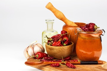 Fresh made Chili Sauce. Red peppers marinated with chilli and garlic. Sale of spices. Food ingredients.