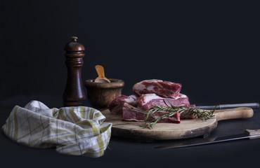 Raw pork ribs with a rosemary