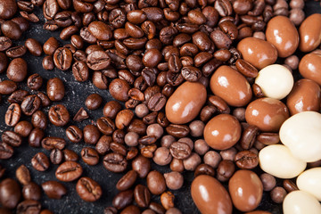 Close up of coffee beans and peanuts in chocolate mixed