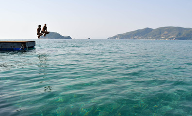 Jumping into the sea from the pontoon.