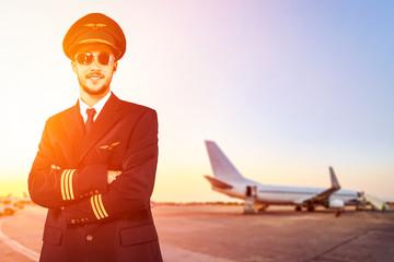 pilot at the airport at sunset