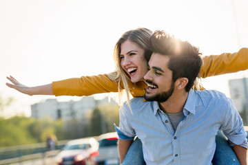 Couple in love having fun carrying piggyback - freedom concept Wall mural