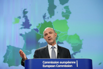 EU Commissioner for Economic and Financial Affairs Moscovici presents the EU executive's spring economic forecasts during a news conference in Brussels