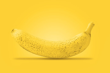 Ripe banana. Raw organic sweet banana on the yellow background. Bananas ready to eat.