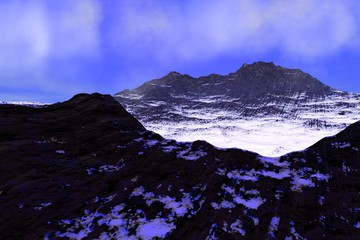 Snowy peaks, an alpine landscape, rocks, beautiful mountains and a blue sky with white clouds.