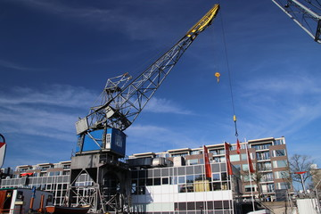 Old cranes, shiips, towers, trains and other parts of the harbor for public exhibitation in the Leuvehaven in Rotterdam.