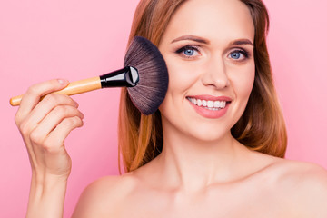 Trend style stylish artist girlish feminine body prepare concept. Close up portrait of gorgeous beautiful pretty sexy with naked shoulders lady cleaning skin from excess powder isolated background