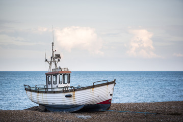 Old fishing boat on Dungeness Beach, Kent, England, UK