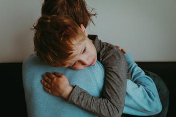 Father comforting sad child, parenting, sorrow