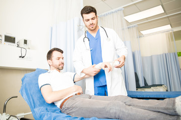 Doctor treating a patient in emergency room