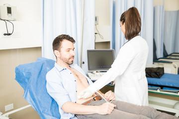 Man having ultrasound scan in hospital
