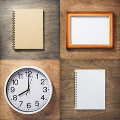 notebook and wall clock at wooden background