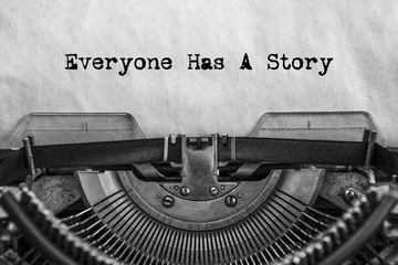 Obraz Everyone Has A Story, typed words on a vintage typewriter. old paper. close-up. my history - fototapety do salonu