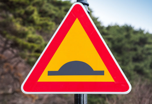 Speed Bump or Uneven Road, traffic sign