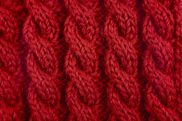 Detail of red cable knitting stitch