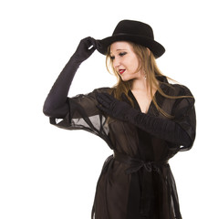 Beautiful young girl in black tunic, black hat and black gloves.