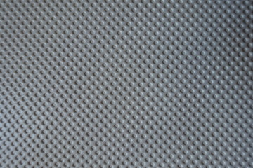 Texture of white material with embossed polka dots