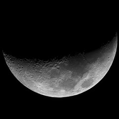 Grey waxing crescent (growing) Moon in a framed black background, taken with large newtonian reflector telescope.