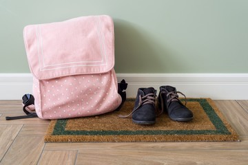 School backpack and boots on the floor Wall mural