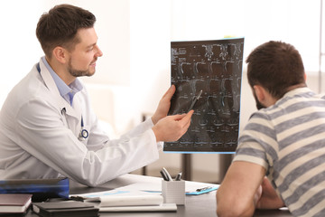 Doctor consulting male patient in clinic