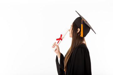 Happy Asian Graduated in cap and gown kiss on certificated feeling so proud and happiness,Isolated on white background,Graduation Success Concept