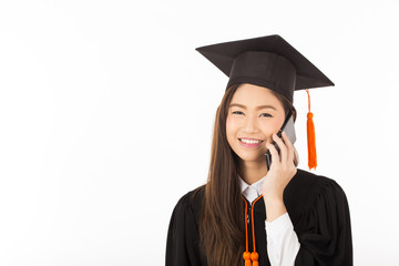 Beautiful Attractive Asian Graduated woman in cap and gown smile and talking with parent in smartphone feeling so proud and happiness,Isolated on white background,Education Success concept