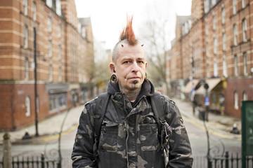Portrait of tattooed man wearing ear plugs