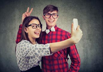 Charming stylish couple taking selfie