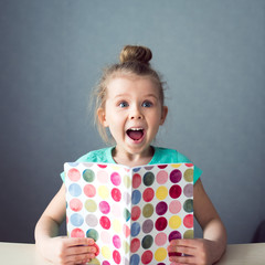 happy girl with notebook shout for joy