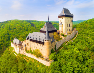 Fotobehang Kasteel Aerial view to The Karlstejn castle. Royal palace founded King Charles IV. Amazing gothic monument in Czech Republic, Europe.