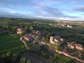 Drone en Cruilles y Monells monasterio Sant Miquel en el Ampurdan en Gerona, Costa Brava (Cataluña,España). Fotografia aerea con Drone.