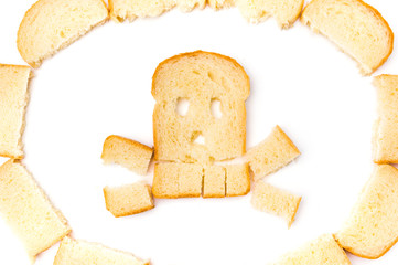 Skull and bones made of sliced bread isolated on white background