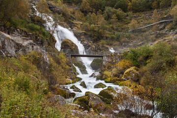 Bridge in front of the Kleivafossen Waterfall