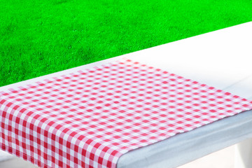 Picnic tablecloth on the table