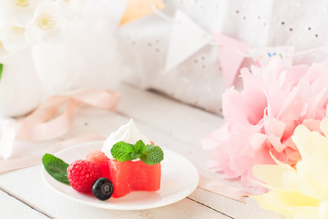 Watermelon stars with berries and ice cream, birthday decoration