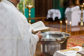priest says a prayer in the church