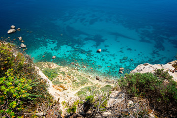Aerial view of coast with clear turquoise sea - Cagliari, Sardinia, Sella del Diavolo.