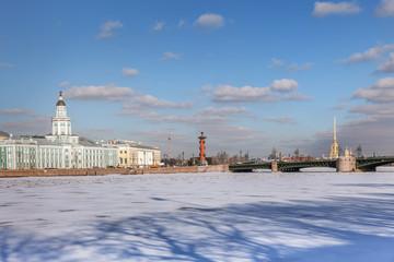 Neva river in winter, Kunstkamera, Palace bridge, Peter and Paul fortress in St. Petersburg