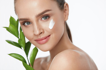 Beauty Face Care. Woman With Cream On Facial Skin