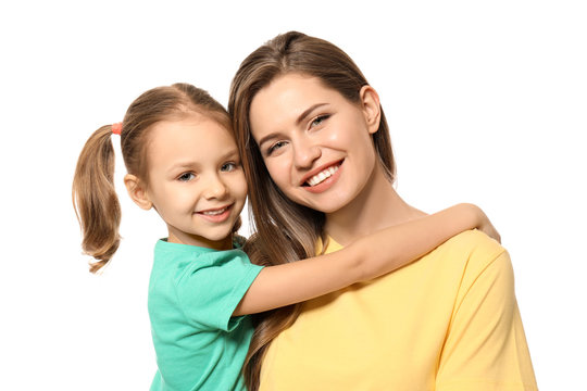 Portrait of mother and cute little daughter on white background