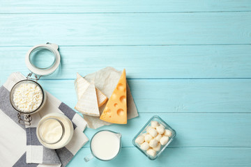 Flat lay composition with different dairy products on wooden background