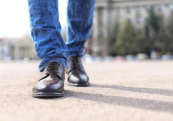 Man in elegant leather shoes outdoors, closeup