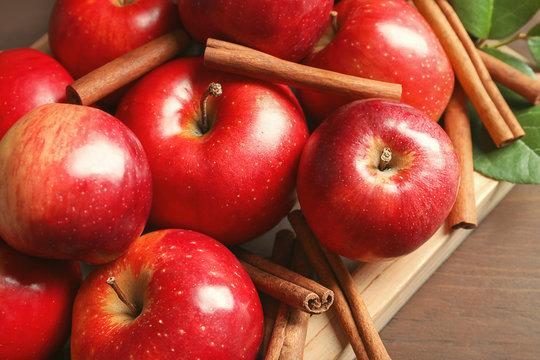 Fresh apples and cinnamon sticks, closeup