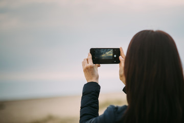 woman is making photo on her cellphone