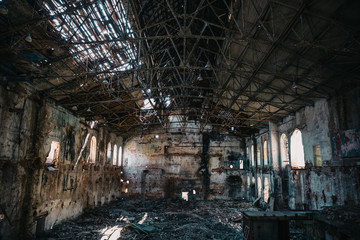 Disaster concept, inside old ruined abandoned industrial factory building, large creepy hall interior